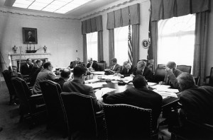 29 October 1962  Executive Committee of the National Security Council meeting. Clockwise from President Kennedy: President Kennedy; Secretary of Defense Robert S. McNamara; Deputy Secretary of Defense Roswell Gilpatric; Chairman of the Joint Chiefs of Staff  Gen. Maxwell Taylor; Assistant Secretary of Defense Paul Nitze; Deputy USIA Director Donald Wilson; Special Counsel Theodore Sorensen; Special Assistant McGeorge Bundy; Secretary of the Treasury Douglas Dillon; Attorney General Robert F. Kennedy; Vice President Lyndon B. Johnson (hidden); Ambassador Llewellyn Thompson; Arms Control and Disarmament Agency Director William C. Foster; CIA Director John McCone (hidden); Under Secretary of State George Ball; Secretary of State Dean Rusk. White House, Cabinet Room.  Photograph by Cecil Stoughton, White House, in the John F. Kennedy Presidential Library and Museum for the image. (Photo courtesy of Wiki Commons)