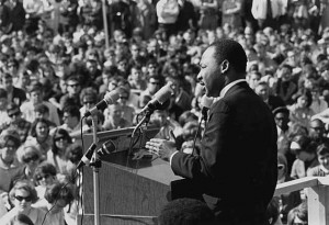 Dr. King giving a speech at an anti-Vietnam War rally at the University of Minnesota, April 27, 1967. After the Voting Rights Act of 1965 was passed, Dr. King began to publicly speak out against the war. (Photo via Wikipedia)