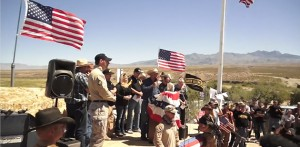 Cliven Bundy and supporters defying federal law enforcement, using loaded firearms. Double standard here? (YouTube)