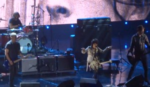 "Joan Jett performing ""Smells Like Teen Spirit"" with the surviving members of Nirvana, at the Rock and Roll Hall of Fame induction ceremony. (Photo via YouTube Video)"