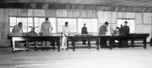 Delegates sign the Korean Armistice Agreement in Panmunjon, July 27, 1953. (Photo via Wikipedia)